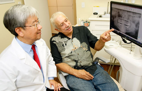 Patient receiving implant consultation